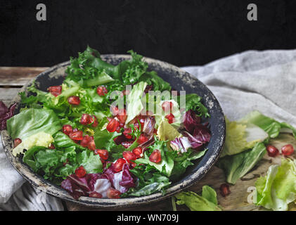 High Angle View Of Salad In Plate On Table Against Black Background - Stock Photo