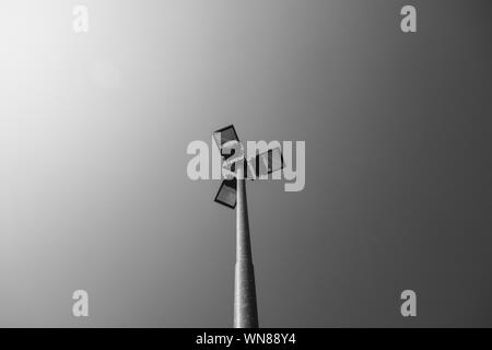 Low Angle View Of Floodlights Against Sky - Stock Photo