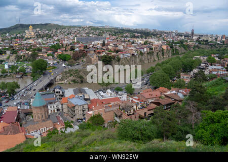 View from the Narikala Fortress of the Tbilisi old town and its suburbs on the banks of Mtkvari or Kura River in Georgia - Stock Photo