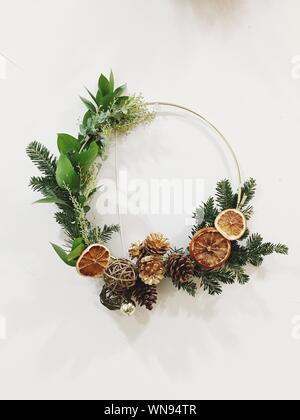 Directly Above Shot Of Christmas Decorations Over White Background - Stock Photo