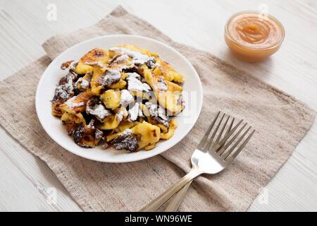Homemade german Kaiserschmarrn pancake on a white plate, side view. Closeup. - Stock Photo