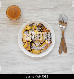 Homemade german Kaiserschmarrn pancake with apple sauce on a white wooden background, top view. Flat lay, overhead, from above. Close-up. - Stock Photo