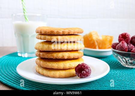 Shortbread dairy cookies with milk and honey. A stack of cookies on a plate. - Stock Photo
