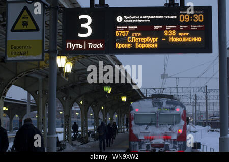 Vitebsky railway station,Saint Petersburg,Russia - January 24, 2019: Luminous scoreboard with the schedule of trains in Russian and duplication in Eng - Stock Photo