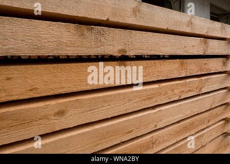 cleanly stored wooden beams fresh from sawing - Stock Photo