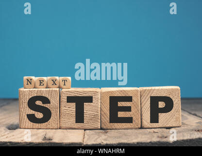 Wooden blocks with the words Next step, motivation or career concept - Stock Photo