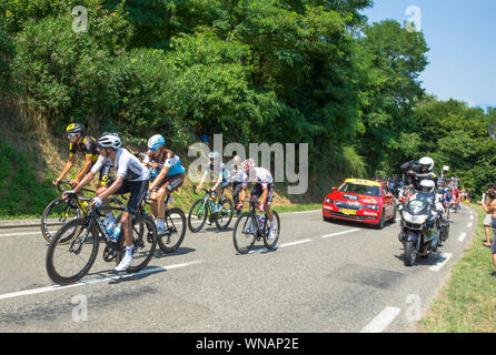 The 2018 Tour de France cycling race.At the back of the peloton near the market town of Maurbourguet. Hautes-Pyrenees.Southwest France. - Stock Photo
