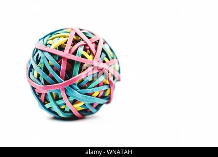 Close-up Of Ball Made With Colorful Rubber Bands Against White Background - Stock Photo