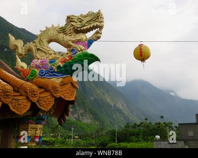 Low Angle View Of Chinese Dragon At Roof Edge Stock Photo
