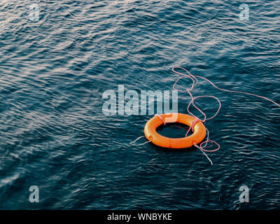 High Angle View Of Life Belt Floating On Water - Stock Photo