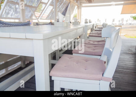 Interior of wooden traditional taverna next to the beach. Greece. - Stock Photo