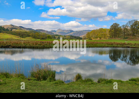 Stunning view of the mountainsm at Langdale Pikes, over Elter Water, near Ambleside, Cumbria, United Kingdom - Stock Photo