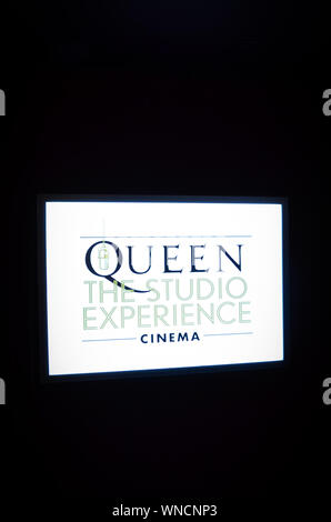Montreux, Switzerland - July 26, 2019: Illuminating screen with sign Queen, The Studio Experience, Cinema. Taken in Montreux Casino, where the famous band recorded their albums. Public exhibition. - Stock Photo