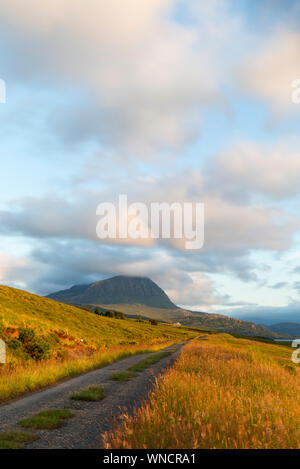 Road along Loch Hope with Ben Hope in the distance, Sutherland - Stock Photo