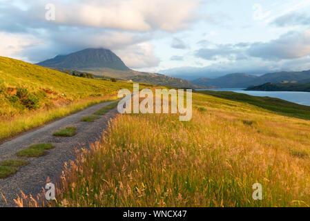 Narrow road along Loch Hope, Highland Scotland - Stock Photo