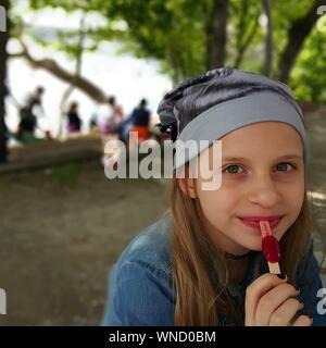 Portrait Of Girl Eating Popsicle - Stock Photo
