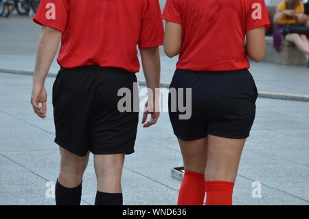 Midsection Of Female Soccer Players Wearing Red Jersey - Stock Photo