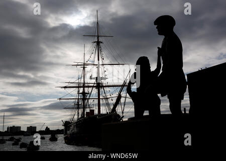 Mudlarks,Statue,children,retrieving,coins,Hard,Mudlarking,HMS Warrior,Naval,Docks,Portsmouth,Hampshire,England,UK, - Stock Photo