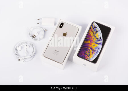 BURGAS, BULGARIA - NOVEMBER 8, 2018: Apple iPhone Xs Max Silver on white background, back view. Charger, earpods and adapter accessories. - Stock Photo