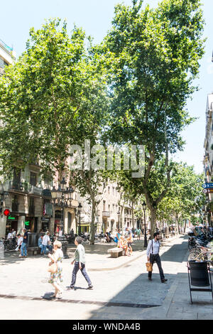 BARCELONA - JUNE 20, 2019: People hanging out and walking around El Passeig del Born, a rectangular open space which stretches from the Santa Maria de - Stock Photo
