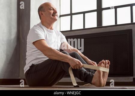 yoga practice intense spread leg stretch stock photo