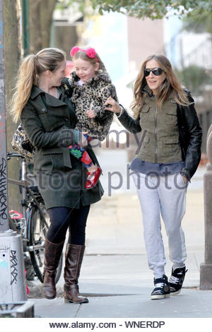 1New York, NY - Sarah Jessica Parker walks back home with her daughter Marion after she was not feeling good and needed to go back home for the day. On the way back home they found a leaf necklace laying on the ground. AKM-GSI April 17, 2014 - Stock Photo