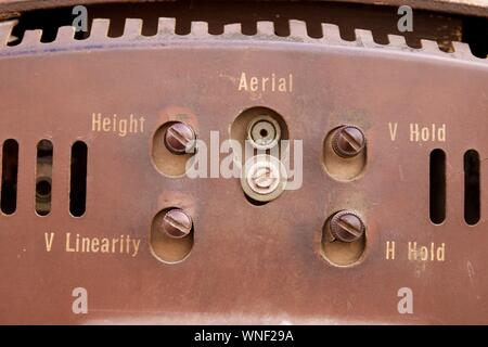 close-up-of-knobs-on-vintage-television-