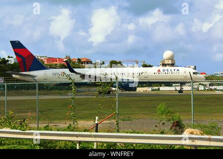 Princess Juliana International Airport, Sint Maarten - August 19th 2019: A Delta Air Lines Boeing 757 taxiing on the runway as it prepares to take off - Stock Photo