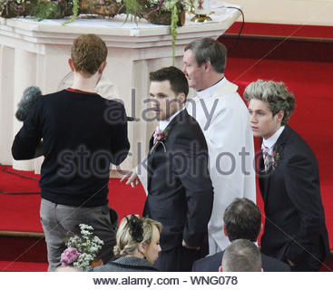 Dublin, Ireland - 'One Direction' singer Niall Horan drove himself in his Range Rover to the wedding of his brother Greg Horan to Denise Kelly at St. Michael's Church Castletown. Niall greeted 100 waiting fans on the church ground for two minutes after the ceremony, but refused to pose for pictures with the bride and groom after the ceremony. The bride and groom did pose for the waiting press despite the cold and snowy weather. AKM-GSI March 27, 2013 - Stock Photo