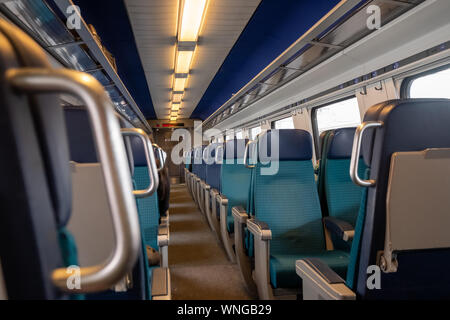 Perspective view of seats in a modern train, nobody - Stock Photo