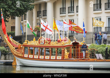 St. Katharine Docks, London, 06th Sep 2019. The Gloriana, the Queen's Rowbarge, elegantly floats in the water. Classic boats and barges, decorated smaller vessels and water craft are moored in St. Katharine Docks for the annual Classic Boat Festival. The free festival also features food and drink stalls, stages, bands and free paddle boarding and other activities, and is on for three days until Sunday 8th September. Credit: Imageplotter/Alamy Live News Credit: Imageplotter/Alamy Live News - Stock Photo