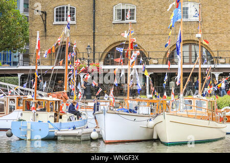 St. Katharine Docks, London, 06th Sep 2019.Classic boats and barges, including the Royal barge Gloriana, decorated smaller vessels and water craft are moored in St. Katharine Docks for the annual Classic Boat Festival. The free festival also features food and drink stalls, stages, bands and free paddle boarding and other activities, and is on for three days until Sunday 8th September. Credit: Imageplotter/Alamy Live News Credit: Imageplotter/Alamy Live News - Stock Photo