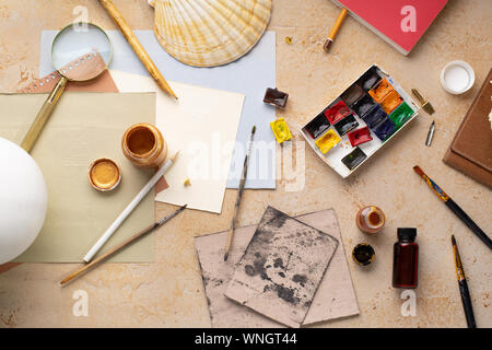 Artist's workspace flatlay. Art equipment on rustic background. Overhead image with copy space. - Stock Photo