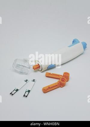 High Angle View Of Medical Equipment On White Background - Stock Photo