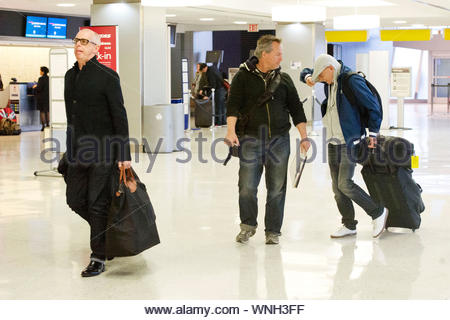 New York, NY - Pet Shop Boys, Neil Tennant and Chris Lowe try to go under the radar as they arrive at JFK airport in New York. Keyboardist, Chris Lowe tried to hide from the camera under his hoody unsuccessfully. The electronic pop duo where leaving town after their show at Terminal 5 in New York City. AKM-GSI April 29, 2014 - Stock Photo