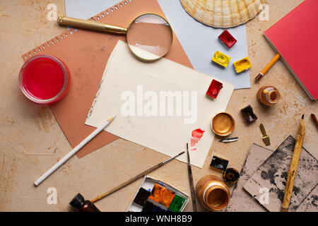 Artist's workspace flatlay. Art equipment on rustic background. Top view with copy space. - Stock Photo