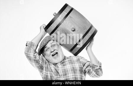 Fermentation product. Natural wine made out of organic grapes. Winery concept. Homemade wine. Man bearded senior carry wooden barrel for wine white background. Producing wine family tradition. - Stock Photo