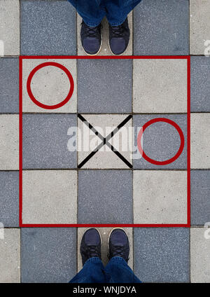 High Angle View Of Tic-tac-toe Game On Ground - Stock Photo