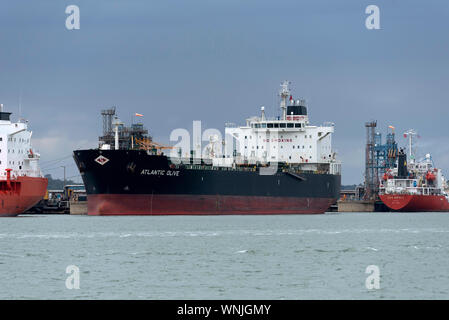 Southampton Water, England, UK, September 2019. Chemical, oil products tanker Atlantic Olive off loading cargo at Fawley refinery on Southampton Water - Stock Photo
