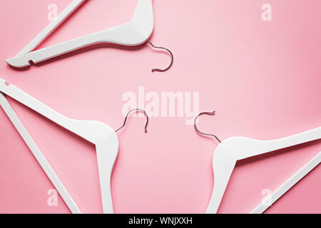 white wooden shoulder on pastel pink background. Fashion feminine blog sale store promo design shopping concept. Flat lay, top view, mockup, overhead - Stock Photo