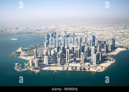 Aerial Wide Shot of Modern Skyscrapers and Apartment Buildings in Downtown Doha (West Bay) on a Sunny Clear Day - Doha, Qatar - Stock Photo