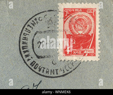 Vintage red postage stamp with the USSR State Emblem and the postmark from Ukraine, 1961, USSR - Stock Photo