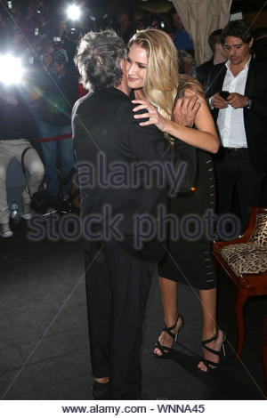 Cannes, France - Rosie Huntington-Whiteley poses with Roberto Cavalli at his yacht party in Cannes. AKM-GSI May 21, 2014 - Stock Photo