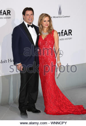 Cannes, France - John Travolta and Kelly Preston at the amfAR party during the 67th Annual Cannes Film Festival. AKM-GSI May 22, 2014 - Stock Photo
