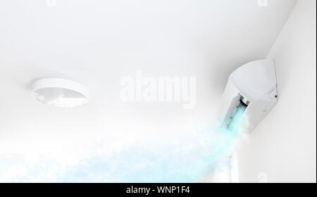 Air conditioner in white room blowing cold air - Stock Photo