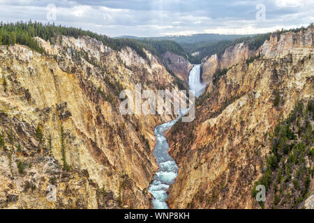 Lower Falls and Grand Canyon of the Yellowstone from Artist Point. The canyon is 20 miles long, over 1,000 feet deep and up to 4,000 feet wide. - Stock Photo