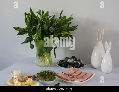 Traditional, polish Easter table with colored eggs, boiled eggs - Stock Photo