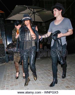 London, UK - Michelle Rodriguez is all smiles as she arrives at Chiltern Firehouse in London with some friends. AKM-GSI May 31, 2014 - Stock Photo