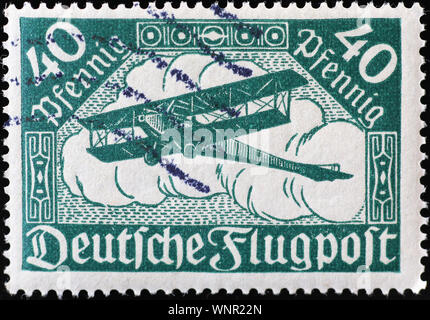 Ancient biplane on old german postage stamp - Stock Photo