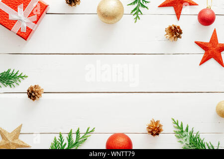 Christmas composition. Red gifts, decorations, fir tree branches, pine cones on wooden white background. Christmas, winter holiday, new year concept. - Stock Photo